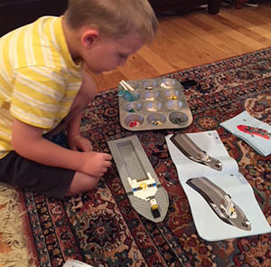 Our grandson, Xavier, builds his own models