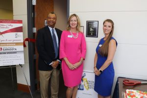 From left, Chief Judge Charles Williams, Jessica Farrelly, president of the Sarasota Chapter of the Florida Association for Women Lawyers (FAWL), and Attorney Nicole Price attended the ribbon cutting.