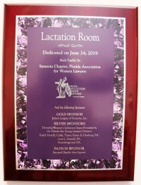 A dedicated plaque hangs outside of the Lactation Room.