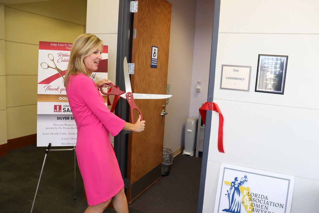 Icard Merrill Attorney Jessica Farrelly, president of the Sarasota Chapter of the Florida Association for Women Lawyers (FAWL), cuts the ribbon on a new Lactation Room at the Judge Lynn N. Silvertooth Judicial Center in Sarasota